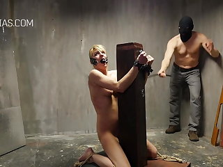 Whipping Poor slave girl tied to a pole and harshly whipped