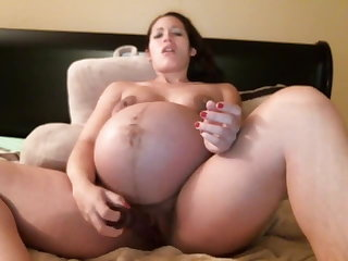 Puffy Nipples 9 month pregnant horny girl playing with her dildo