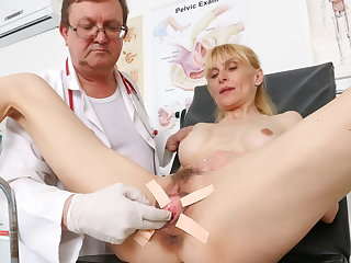 Medical Slim mature woman's pussy check-up